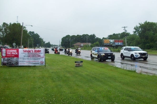 A large group of motorcyclists participating in the 2019 Silvie's Ride Against Child Abuse were escorted by the Macomb Police Department as they left the Macomb Elks Lodge.