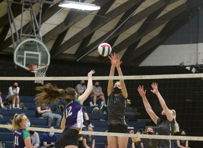 West Prairie's Maleigha Huston goes up for a block during Tuesday's match.