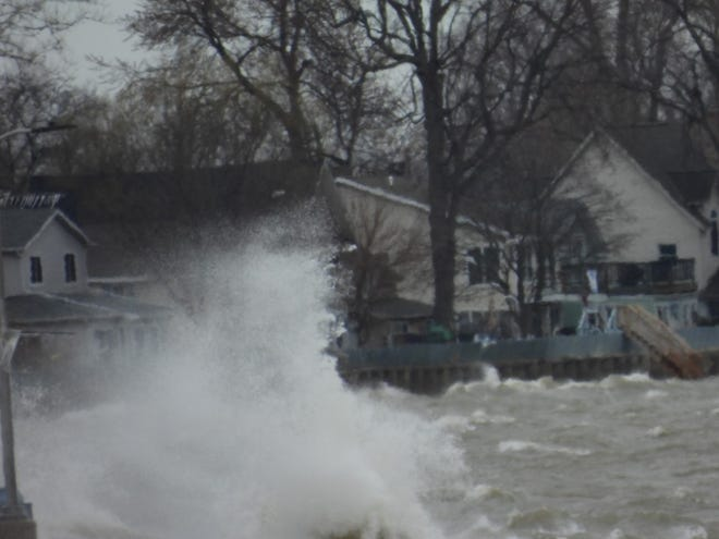 Waves pound the Monroe County shoreline earlier this week. A lakeshore flood warning is in effect for Thursday.