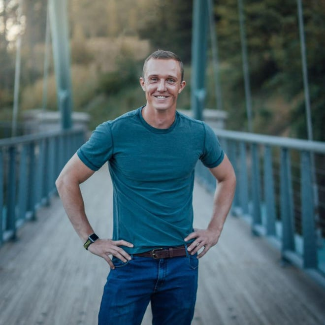 Professional snowboarder Robby Burns at Wagon Creek Bridge at Mount Shasta's Lake Siskiyou. Burns, who has dreams of representing the U.S. in the Olympics, grew up in Mount Shasta.