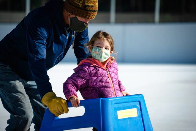 Two people enjoy the Siskiyou Ice Rink in Mount Shasta last season. During the pandemic, the ice rink saw record attendance.