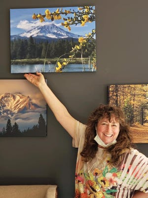 Mt. Shasta Area Newspapers correspondent Shareen Strauss presents canvas prints of her photographs, which are on display at Mossbrae Hotel in Dunsmuir through mid-April.