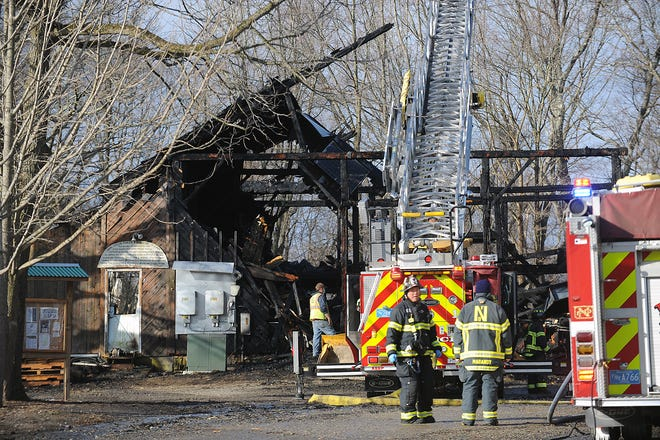 Firefighters on the scene of an overnight fire that destroyed the historic barn at the Natick Community Organic Farm, March 17, 2021. Three sows and 14 piglets died in the fire.