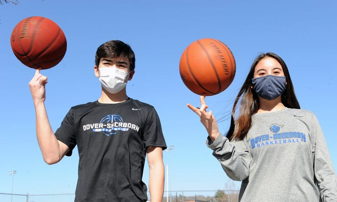 Dover-Sherborn Regional High School sibling Tri-Valley League Basketball All-Stars, senior Evan Skeary, and his sophomore sister, Hana, outside the gym, March 17, 2021.