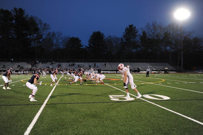 The Natick High School football team will have to wait until April 15 to play Framingham High. This Friday's game between the rivals is postponed, because a Natick player tested positive for COVID-19.