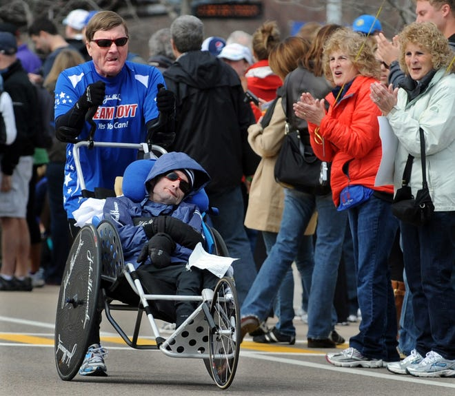 Dick and Rick Hoyt running their 30th Boston Marathon in 2013, pictured here in Framingham.