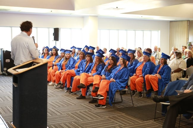 Oklahoma County District Court Judge Ken Stoner gives the commencement address at a 2019 Prison Fellowship Academy graduation at Kate Barnard Correctional Center.