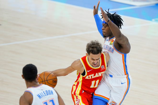 Hawks guard and former Sooners star Trae Young drives against Thunder guard Luguentz Dort.