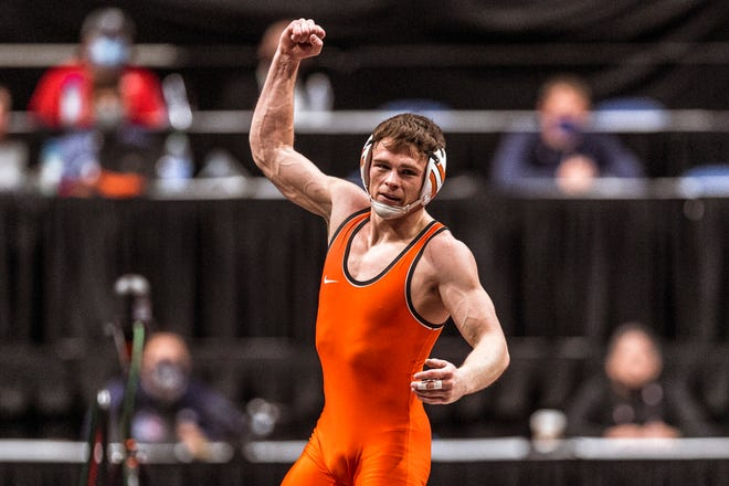 Oklahoma State wrestler Boo Lewallen celebrates after winning the Big 12 championship at 149 pounds on March 7.