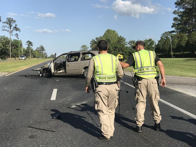 Two FHP troopers on scene of a recent traffic fatality.