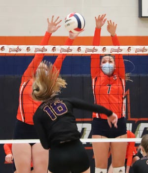 Pontiac's Brynn Pickett, left, and Ellie Wright go up to block an attack from Monticello's Renni Fultz during Tuesday's match at PTHS. Monticello won in two sets.