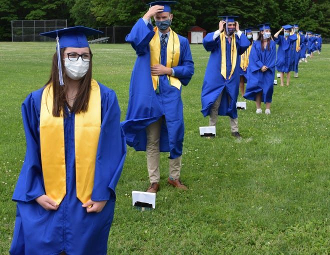Masked and six feet apart, seniors of Kennebunk High's Class of 2020 prepare to receive their diplomas during a special graduation ceremony tailored to the restrictions of the COVID-19 pandemic last June.
