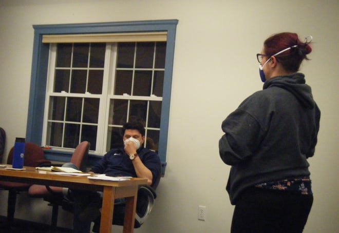 Kimberly Leo asks for discussion to be reopened on the Brentwood Newsletter and alleged racism as new Board of Selectmen member Jonathan Frizzell listens at Tuesday's board meeting.