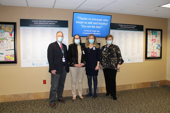 The Wentworth-Douglass Emergency Response Fund Donor Wall was recently unveiled at Wentworth-Douglass Hospital. Pictured from left to right: Jeffrey Hughes, MPH, FACHE, Interim President & CEO; Jackie Eastwood, Chair, Foundation Board of Directors; Sheila Woolley, RN, BSN, MPH, Chief Nursing Officer; and Cristine More, CFRE, Chief Philanthropy Officer.