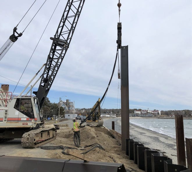 A crew on installs part of a new steel sea wall on Beach Avenue in Kennebunk on Tuesday, March 16, 2021.