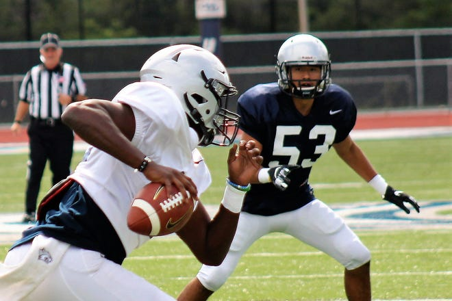 Former Dover High School standout Aaron Oroh (53), shown here in the 2019 Blue-White scrimmage, is focused on making his college debut this season for the UNH football team.
