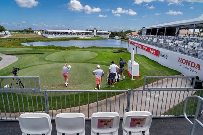 Rory Sabbatini tees off on the 17th hole with Anirban Lahiri watching during a practice round Tuesday at PGA National for this week's Honda Classic. Fans attending the event - and watching from the Bear Trap - will find a very different setup and new rules due to the coronavirus pandemic.