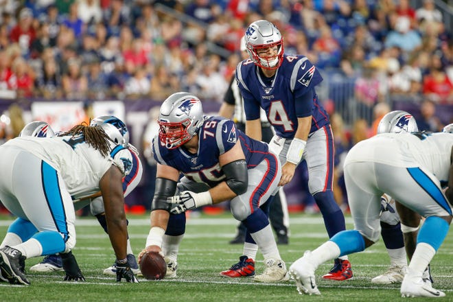 According to a source, Ted Karras, shown playing center in a preseason game in August 2019, has returned to the Patriots after a year in Miami.