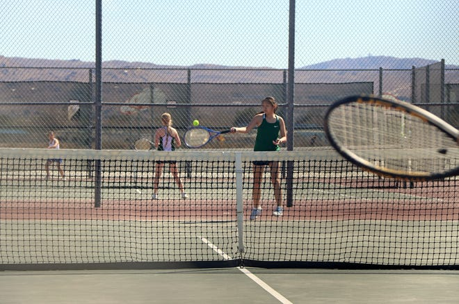 Hannah Ostermann returns a serve from Serrano's No. 1 player during Tuesday afternoon's match. Ostermann won two of three sets, helping the Lady Burros pick up a 12-6 win over Serrano.