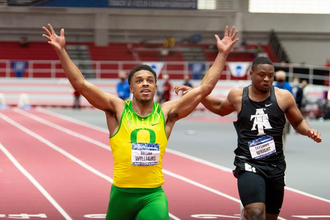 Oregon's Micah Williams celebrates his win in the men's 60-meter dash at the NCAA Indoor Track and Field Championships on March 13 in Fayetteville, Ark.