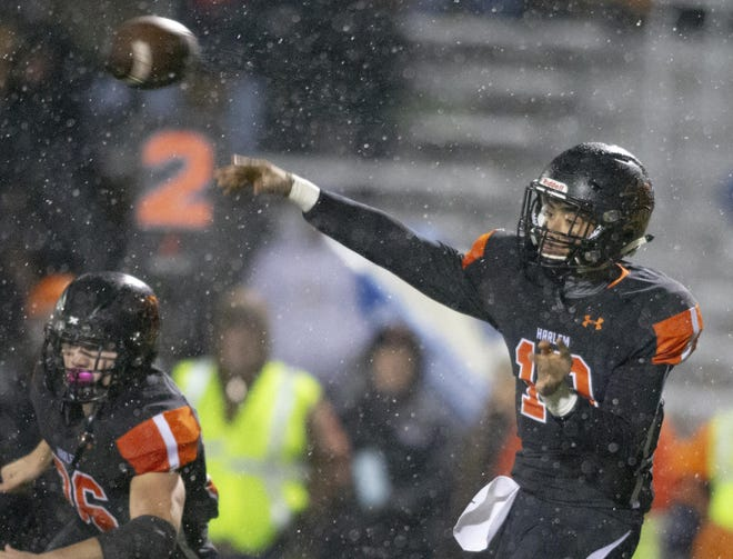 Harlem's James Cooper Jr., shown during the Class 7A playoffs in 2019, is the NIC-10's all-time leader in passing TDs. Cooper and the Huskies are expected to compete for the league title this spring.