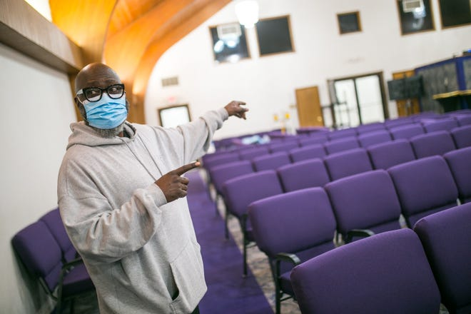 The Rev. Kenneth Copeland, pastor of New Zion Missionary Baptist, shows the church's sanctuary Wednesday in Rockford, where medical providers will administer COVID-19 vaccinations to residents.
