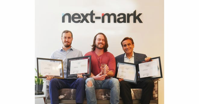 Next-Mark team members Marco Vannucci, left, Ryan Hoevenaar and Joseph Grano, with their 2021 ADDY Awards.