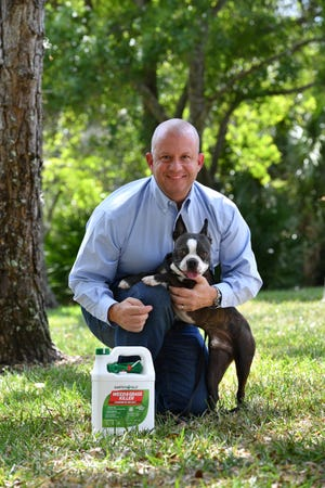 Earth's Ally CEO Scott Allshouse with his dog, Bruno, and a sprayer bottle of Earth's Ally Weed and Grass Killer. Earth's Ally products use all natural ingredients, are 100% nontoxic, and pet-safe. Earth's Ally has seen growth during the past year as pandemic gardening's popularity continues to soar nationwide.