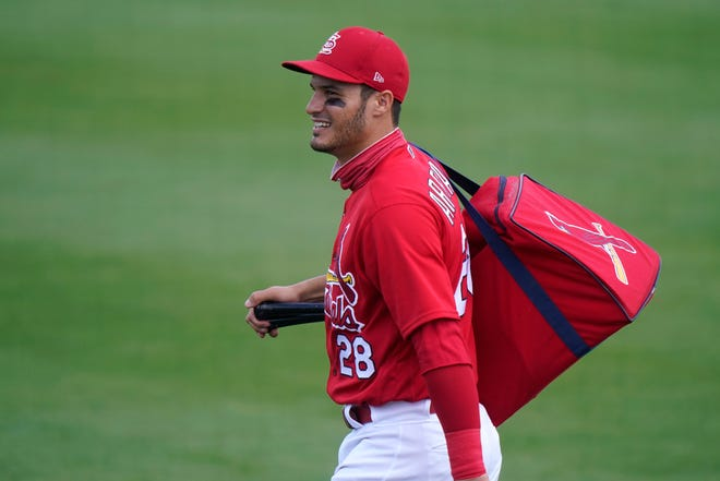 St. Louis Cardinals third baseman Nolan Arenado walks onto the field before a spring training baseball game against the Washington Nationals on Monday, March 15,  in Jupiter, Fla.