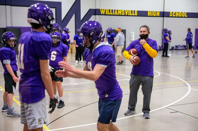 Williamsville football coach Aaron Kunz goes through a drill with his players last spring. The Bullets open the season Friday against Union Grove of Wisconsin, in a game played in LaSalle.