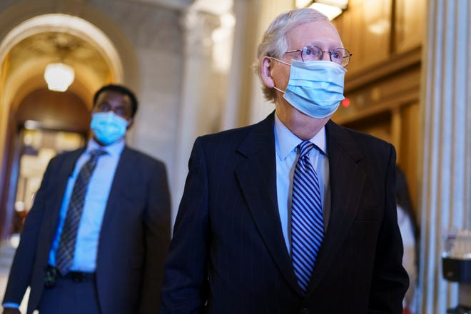 Senate Minority Leader Mitch McConnell, R-Ky., leaves the chamber after criticizing Democrats for wanting to change the filibuster rule, at the Capitol in Washington, Tuesday, March 16, 2021. (AP Photo/J. Scott Applewhite)