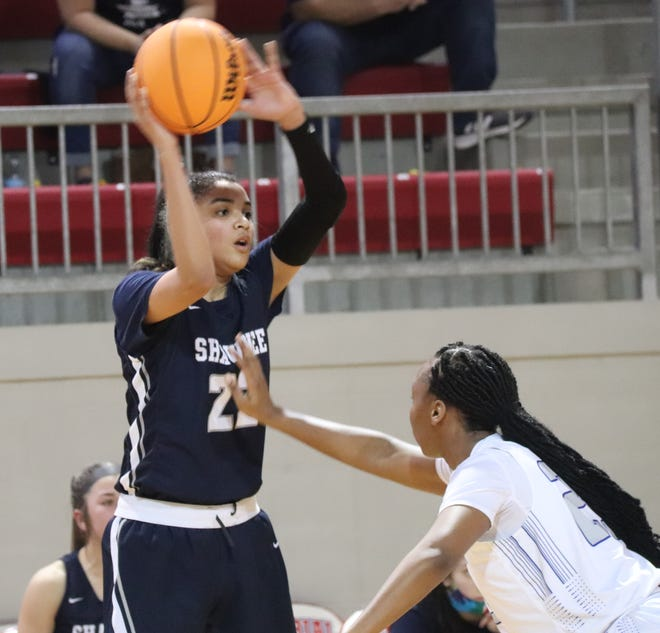 Shawnee sophomore Amaya Martinez scans the court with the ball during the first round of the Class 5A State Tournament last Thursday in Tulsa.