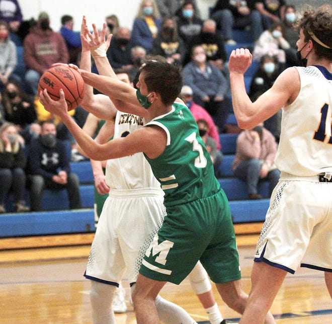 Charlie Newburry of Mendon hauls in a rebound against Centreville on Tuesday.