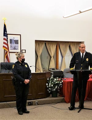 Springfield Township Police Chief Jack Simone swears in new department Capt. Denise Moore.