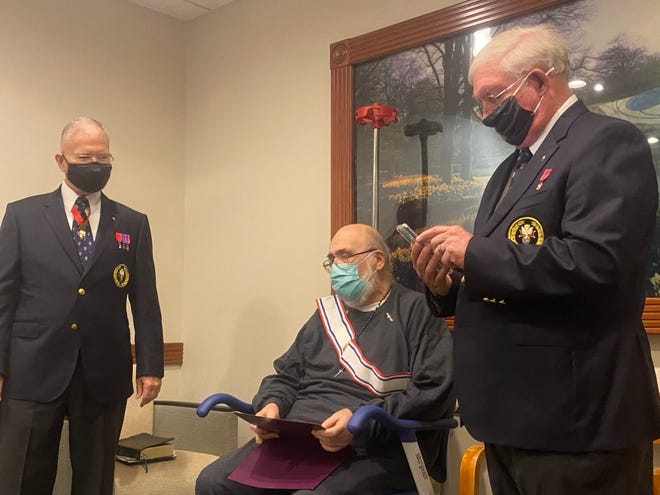 Fourth degree Knights of Columbus recipient and cancer patient Michael Flynn sits between District Master JP Horvat Jr. and Faithful Navigator Doug Uhland. (Bill Hand / Sun Journal Staff)