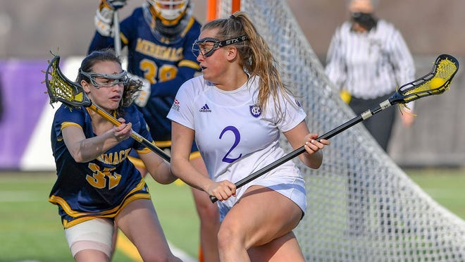 Jolie Creo recorded a career-high 11 points while lifting the Holy Cross women's lacrosse team over Merrimack.
