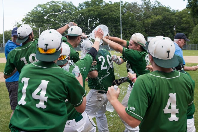 Tahanto baseball players douse coach Neil Greenwald with water bottles after winning the Division 4 Central title in 2019.