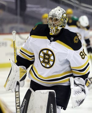 Bruins goaltender Daniel Vladar warms up Tuesday night before his first NHL regular-season start against the Penguins in Pittsburgh.
