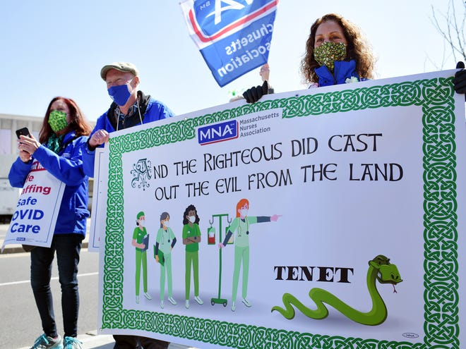 Striking St. Vincent nurses and supporters carry a sign directed at Tenet Healthcare Wednesday outside the hospital.