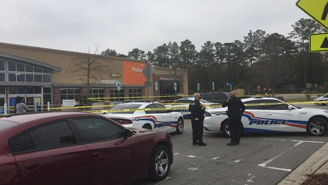 Fayetteville police are on the scene at the Walmart Supercenter on Gillespie Street after a body was discovered in the parking lot.