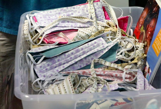 A bin of completed face coverings sewn by volunteers of the Gainesville chapter of Days For Girls International is shown on April 9. The group, which usually sews sanitary napkins for young women around the world, pivoted to sewing cloth masks after the COVID-19 pandemic started.