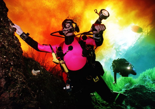 A scuba diver swims through Devil's Eye Springs on the Santa Fe River. [FILE]]