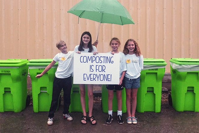 Four children who joined Grandview Heights' Kids that Compost youth team when it began in 2019 stand in front of the food-waste drop-off site the group operates at 1525 Goodale Blvd. in partnership with the city of Grandview Heights. Pictured are (from left) Hudson Barber, Elise Barber, Margaret Yates and Maura Yates.