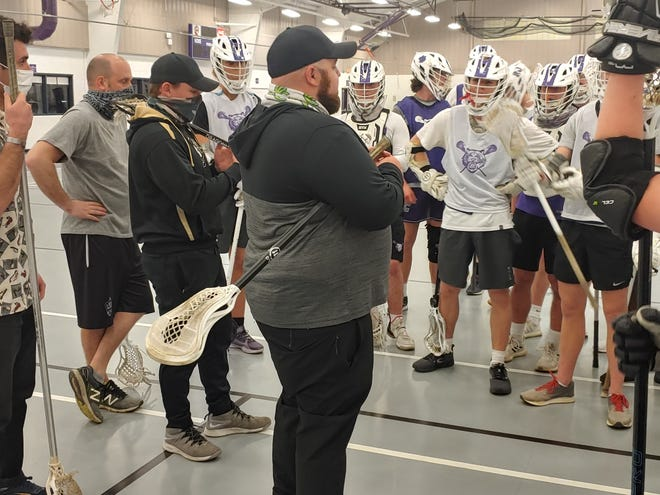 Coach Garyck Todd (center) led the Pickerington Central boys lacrosse to to a 30-23 mark in his three seasons. He was named coach at Wilmington where he played from 2013-16.