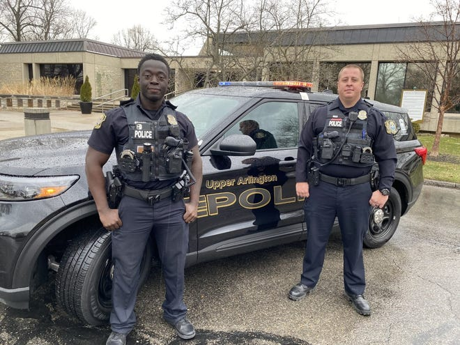 Upper Arlington police officers Emmanuel Boamah, left, and Brandon Rees are credited with helping a woman who was planning to jump March 5 from Hayden Run Bridge in Columbus.