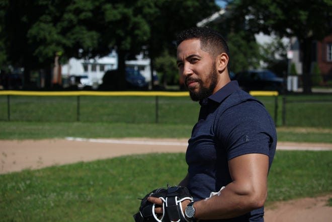 Neil Brown Jr. as Ronnie Russo is shown on set at Healy Playground. In the movie, the character is a New York lawyer who returns to his Boston hometown to reunite his dying friend with his young son.