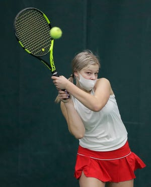 Neenah's Shelby Roth hits a shot against Appleton East during a tennis match March 17 at Valley Fitness and Racquet in Neenah.