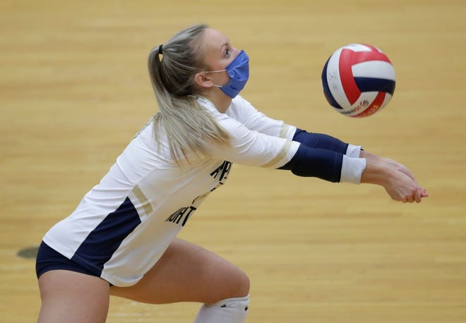 Appleton North's Grace Demetrician digs the ball against Neenah during their Fox Valley Association girls volleyball match Tuesday in Appleton.