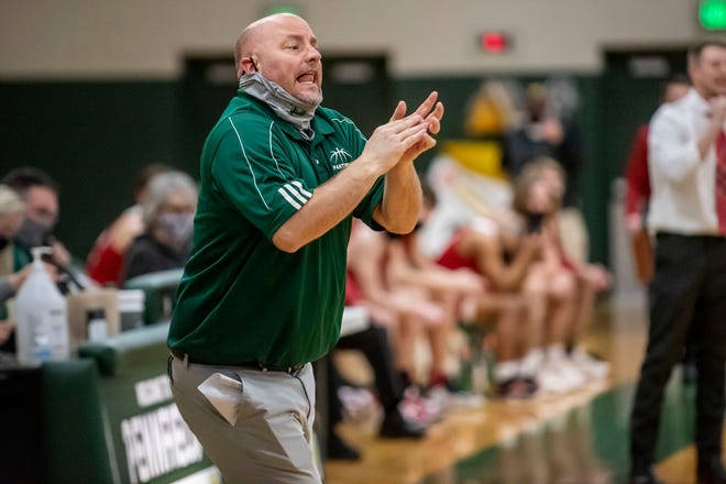 Pennfield head coach Nate Burns calls out to players in the final moments of the game on Tuesday, March 16, 2021 at Pennfield High School. Pennfield defeated Coldwater 44-41, winning the Interstate 8 Conference title.