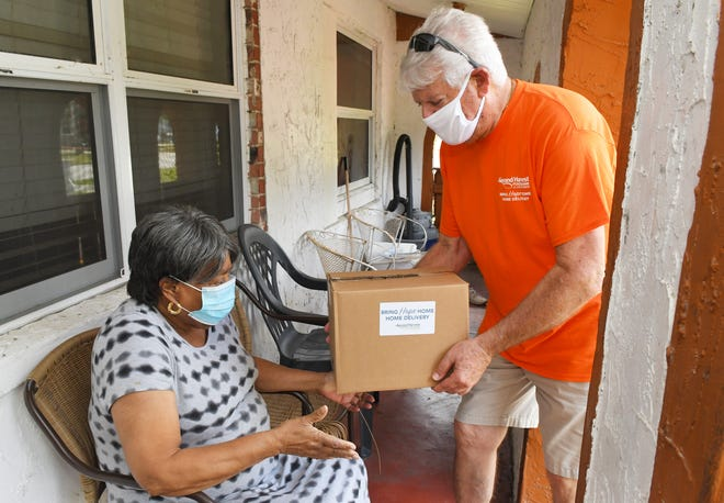 Bob Ericson makes a food delivery to Cocoa resident Eva Smith for Second Harvest's Bring Hope Home program, which partners with Brevard Alzheimer's Foundation for deliveries in Brevard County.